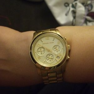 Gold michael kors watch with snap closures